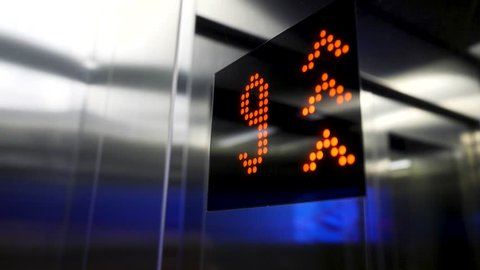 In elevator of modern business center on electronic LCD display. Interior of the elevator inside. View of the panel with the number and steel silver lining. monitor show number floor in elevator 4K