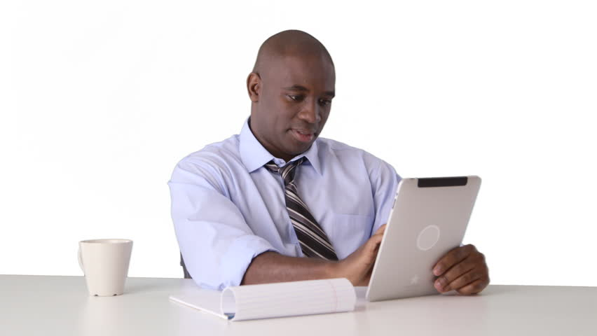 African American businessman working on tablet and taking notes | Shutterstock HD Video #3389423
