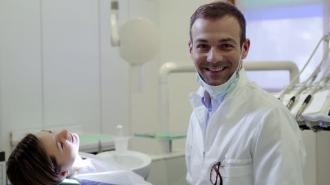 Dental care and hygiene, portrait of adult caucasian dentist at work and smiling at camera with customer sitting on exam chair. Sequence