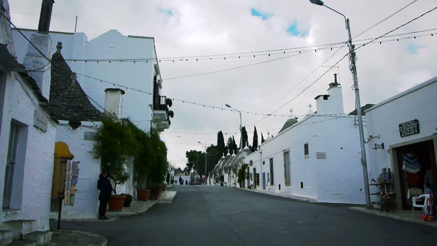 ALBEROBELLO, ITALY - DEC 18: Street leading to Saint Cosma and Damiano Basilica on December, 18, 2013, Alberobello, Italy. Alberobello is UNESCO World Heritage Site highly visited all year round