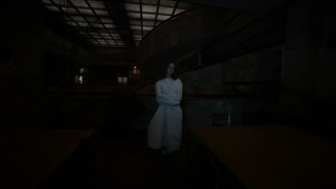 In a dark room, a crazy woman in a straitjacket.
