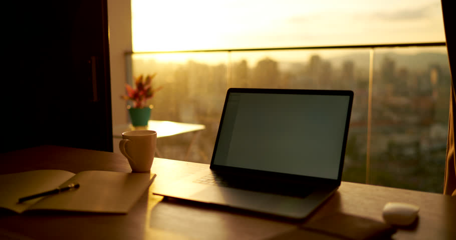 Time lapse of laptop with mock up screen standing on table in home interior working place near window with cityscape view, desktop with modern laptop and diary for remote job | Shutterstock HD Video #33964483