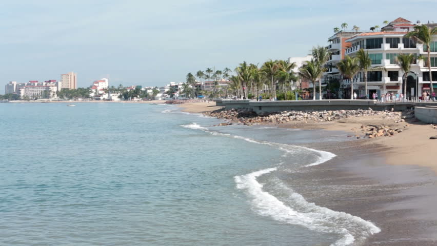 PUERTO VALLARTA, MEXICO NOV 2012: Economy and tourism bringing tourist back to Mexico. Puerto Vallarta city boadwalk bay beach pan. Cultural and artistic center of the city.