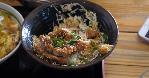CHIANG MAI,THAILAND - CIRCA December 2017 :person eats katsu don