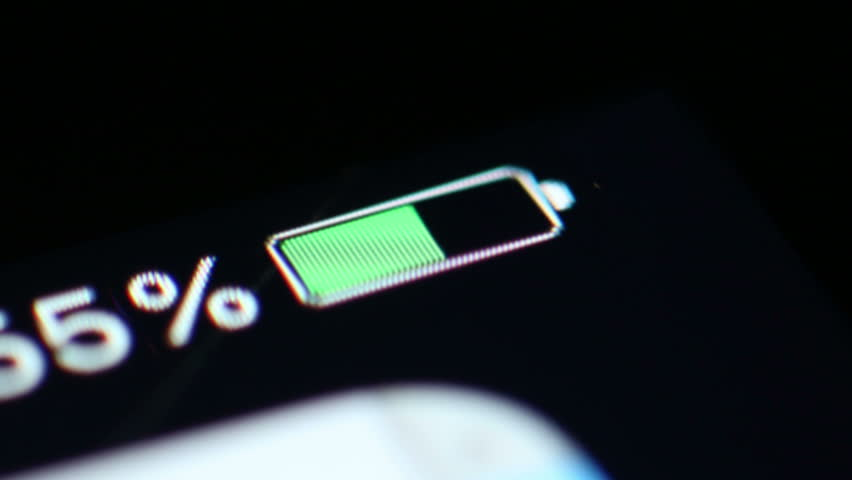 Time Lapse: A Smartphone Battery Drains Power. Close up macro shot of the battery level indicator on a smart phone draining in time lapse.