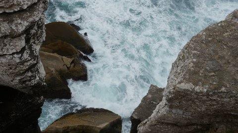 The coast at Cabo Carvoeiro with waves crashing against the rocks, in Portugal