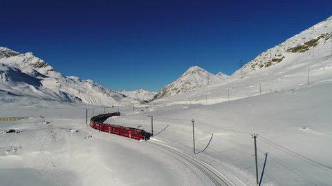 Red train of Bernina, aerial view. Winter landscape