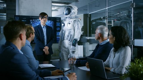 In the Conference Room Chief Engineer Presents Next Generation Space Suit to a Board of Directors. Completely Original Design with Integrated AI and Neural Network Systems. New Level of Space Travel.
