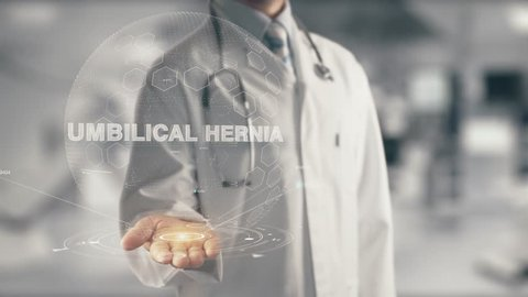 Doctor holding in hand Umbilical Hernia