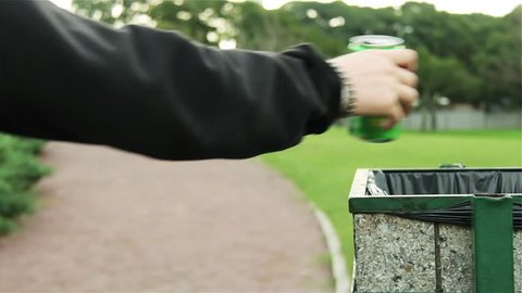 Couple Throwing Garbage in the Garbage Can of the Public Park.