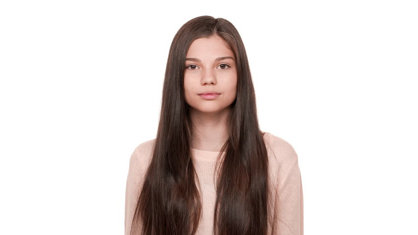 Studio portrait of funny female teen showing mood swings with facial expressions jump from happiness to boredom over white background. Concept of emotions