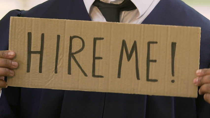 Male student holding hire me sign, future career expectations, opportunities