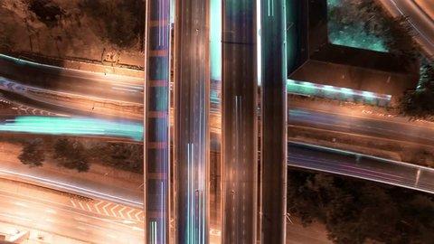 aerial shot view of traffic on freeway interchange at night. 4K UHD timelapse background