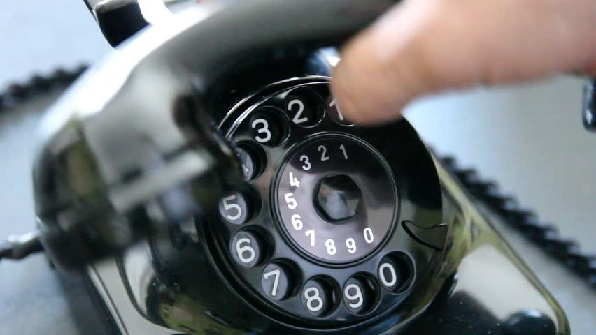 Vintage black telephone. Man dials