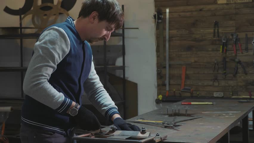 Blacksmith working with metal decorative detail at his workshop, slow motion.  | Shutterstock HD Video #34312903