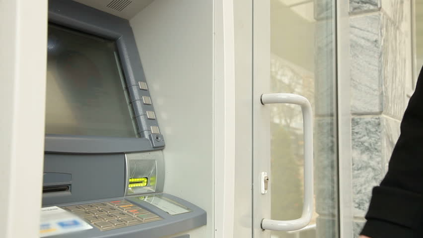 Woman Using Credit Card, Taking Money From ATM Machine