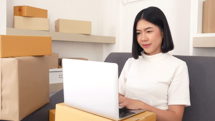 Young Asian Woman Working at home, Young Owner Woman Start up for Business Online, SME, Delivery Project, Woman with Online Business or SME Concept.  | Shutterstock HD Video #34352683