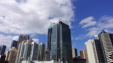 """SYDNEY, AUSTRALIA - SEPTEMBER 27 2017: Time lapse view of Ernst & Young """"ET"""" in Sydney. EY is one of the largest professional services firms in the world and is one of the """"Big Four"""" accounting firms."""