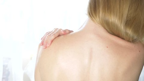 Shoulder and woman back body lotion spreading slow motion close-up, 4k