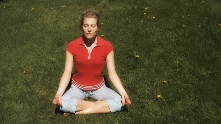 woman practicing relaxation and breathing exercise in an outdoor surrounding