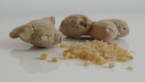 Pile of candied  ginger root slow tilt 4K 2160p 30fps UltraHD footage -