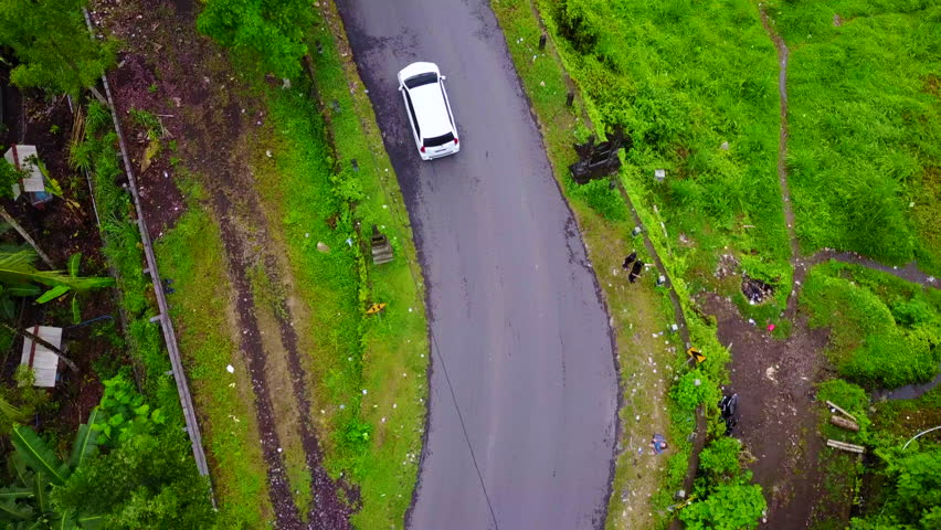 Driving car around road in Bali mountains #34459423