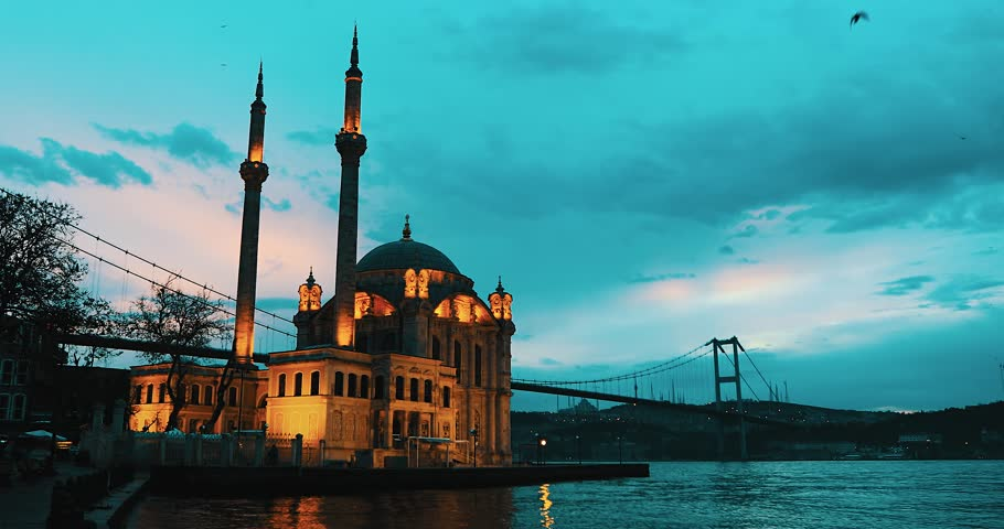 Day to night time lapse scene of the beautiful renovated Ortakoy mosque in Istanbul with Bosphorus bridge in the background. 4K Video
