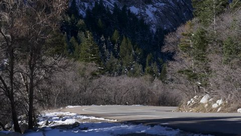 Little Cottonwood Canyon, Utah, March 2016.  A car drives up Little Cottonwood Canyons Road on highway 210 from Salt Lake City.  Alta and Snowbird ski areas located at top of canyon.