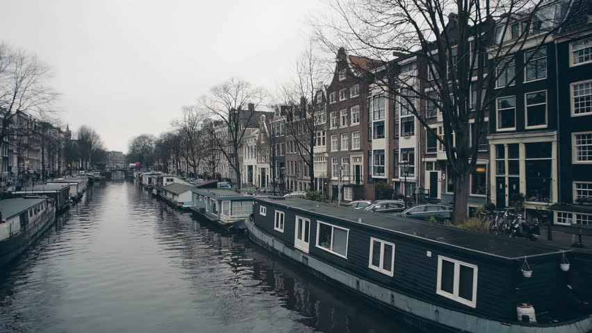Typical houseboats along city canal embakments in Amsterdam, Netherlands