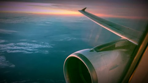 Engine Wing airplane sky concept. View of engine plane from window airplane see wing and sky and cloud sunset beautiful. It flying over above on cloudy sky beauty. Beautiful nature view window plane