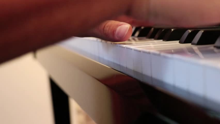 Hands playing piano  | Shutterstock HD Video #34561993