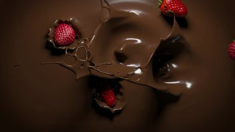 Strawberries fall into melted chocolate