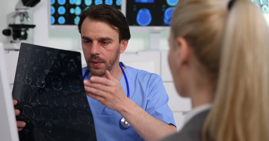 Medical Doctor Man Talking to Patient Woman Bad Diagnostic of Brain Scan | Shutterstock HD Video #34597213