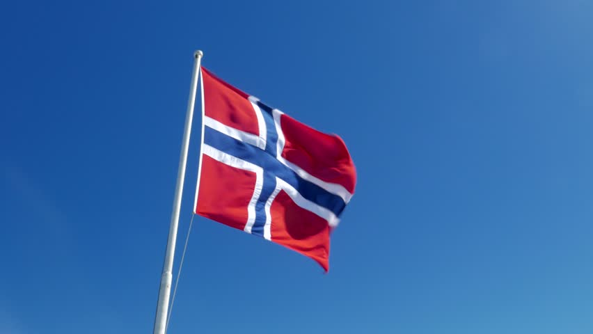 Flag of Norway on the blue sky background.