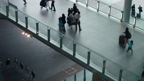 Heathrow Airport, UK 20 July 2016: Looking down on passengers arriving and departing.