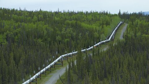 Aerial mountain valley view of Trans Alaska pipeline from Northern Prudhoe Bay oilfields to Valdez Southern Alaska USA