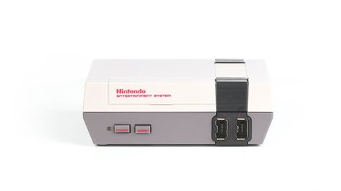BUDAPEST, HUNGARY - DECEMBER 10, 2017: Nintendo NES classic edition video game console spinning. Modernized version of the original with preinstalled games
