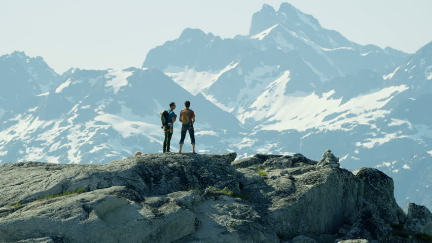 Aerial team expedition of climbers standing on peak of Mount Habrich in Squamish Valley Canada RED WEAPON