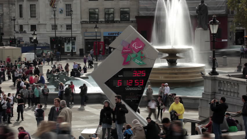 LONDON - OCTOBER 9, 2011: Olympic countdown sign and people walking about