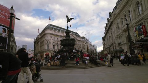 LONDON - OCTOBER 7, 2011: People standing and sitting around the Eros statue in London
