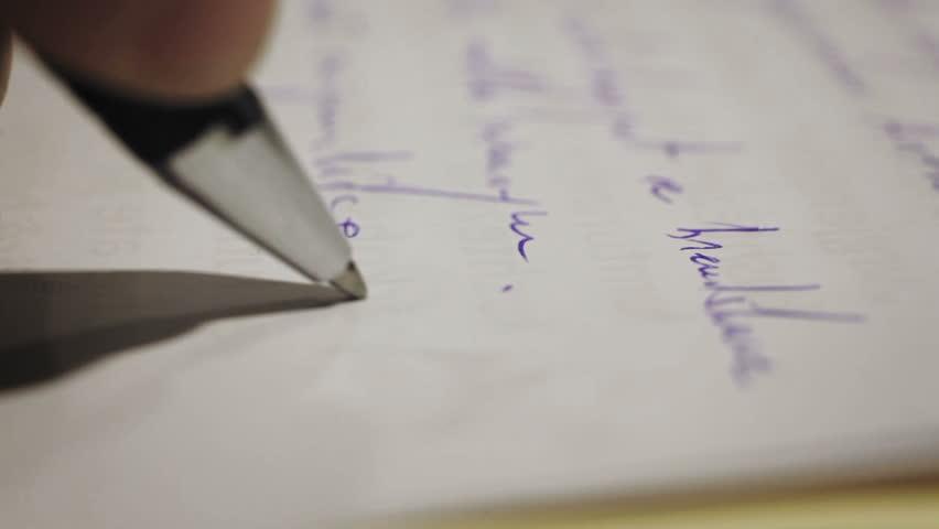 Pen writing a document paper on a desk close up depth of field   Shutterstock HD Video #34691563