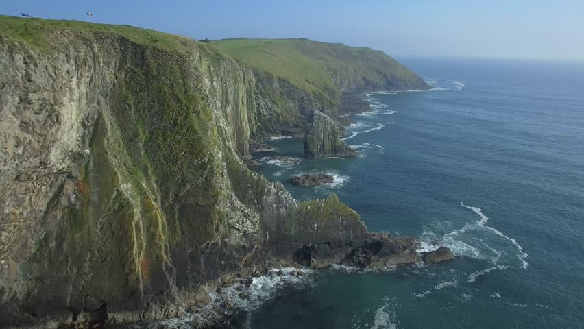 Aerial view of amazing cliffs in sunny day - Old Head of Kinsale, Ireland | Shutterstock HD Video #34715863