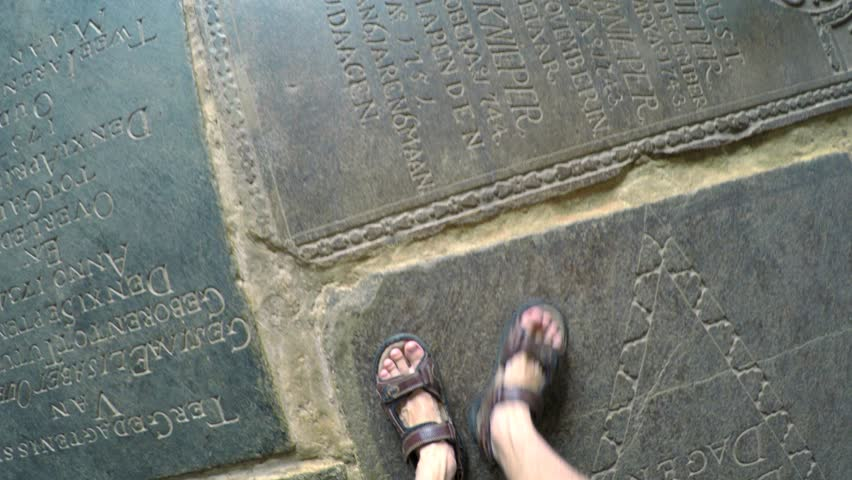 GALLE. SRI LANKA - CIRCA DEC 2016: Sandaled feet walking across antique memorial plaques on the floor of the Dutch Reformed Church. 4k Ultra HD video