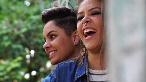 Lesbian Couple Relaxing Smiling