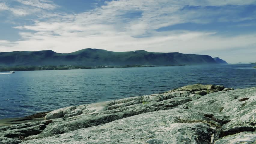 the stone coast of Norway. The boat rides the fjord - HD stock video clip
