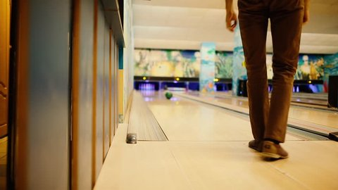 In the game club for bowling, the player throws a bowling ball that knocks down skittles.