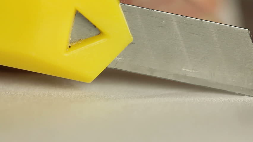 Cutting paper with knife