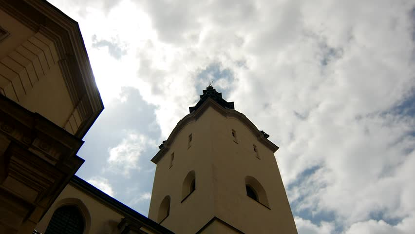 The Archcathedral Basilica of the Assumption of the Blessed Virgin Mary Lviv. Blue cloudy sky on the background.