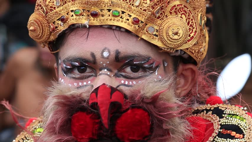 GIANYAR, BALI, INDONESIA - JANUARY 08, 2018 : Unknown Balinese man, wearing a Hanuman mask, participates in a street ceremony, during a pre-election rally, the Indonesian Democratic Party of Struggle