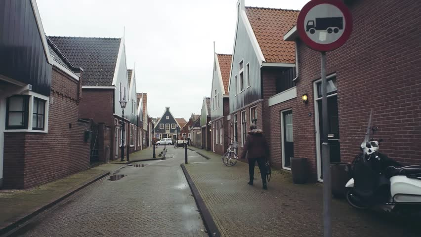 POV walk along traditional Dutch town street in Volendam, Netherlands